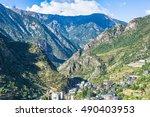 city in a valley between the... | Shutterstock . vector #490403953