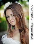 Small photo of Portrait of allure bride with white flower in her brown hair