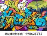 Small photo of Art under ground. Beautiful street art graffiti style. The wall is decorated with abstract drawings house paint. Modern iconic urban culture of street youth. Abstract stylish picture on wall