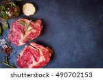 Raw Juicy Ribeye Steaks With...