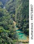 Small photo of Beautiful turquoise pools and limestone bridges surrounded by the jungle in Semuc Champey, Alta Verapaz region, Guatemala