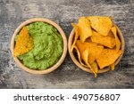 Guacamole With Nachos On Woode...