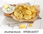 Potato Chips On A Parchment On...