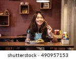 woman eating steak in a...   Shutterstock . vector #490957153