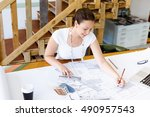 young woman architect in office | Shutterstock . vector #490957543