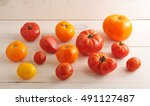 red and yellow tomatoes on... | Shutterstock . vector #491127487