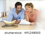 middle aged couple relaxing at... | Shutterstock . vector #491248003