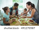 smiling woman serving meal to... | Shutterstock . vector #491270587