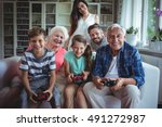 family watching the kids... | Shutterstock . vector #491272987