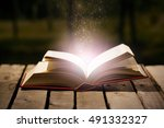thick book lying open on wooden ... | Shutterstock . vector #491332327