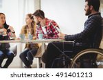 coworker on wheelchair using... | Shutterstock . vector #491401213
