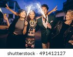 group of friends holding... | Shutterstock . vector #491412127
