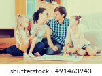 cheerful young parents and two... | Shutterstock . vector #491463943