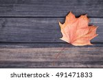 yellow maple leaf on wooden... | Shutterstock . vector #491471833