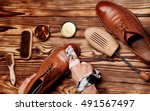shoes master polishing shoes... | Shutterstock . vector #491567497