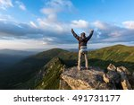 alone tourist on mountain top | Shutterstock . vector #491731177