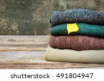 pile of colorful warm clothes... | Shutterstock . vector #491804947