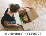 woman opening a vegetable... | Shutterstock . vector #491848777