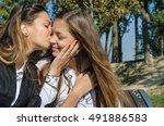 mother kissing daughte  hugging ... | Shutterstock . vector #491886583