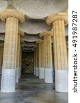 Small photo of Doric columns hold the central terrace with serpentine seating in Parc Guell designed by Antoni Gaudi. Carmel Hill, Barcelona, Spain.
