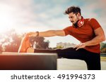 young man stretching muscles... | Shutterstock . vector #491994373