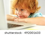 happy redhead boy playing on... | Shutterstock . vector #492001633