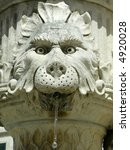 One of many small fountains (lion) in Dubrovnik. - stock photo