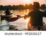 meeting sunset on kayaks. rear... | Shutterstock . vector #492010117