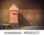 Postbox In Front Of Rows Of Ol...