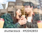 young couple eating wrap and... | Shutterstock . vector #492042853