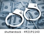 pair of handcuffs closeup on... | Shutterstock . vector #492191143