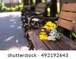 bouquet on the bench. yellow... | Shutterstock . vector #492192643