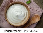 plain yogurt in wooden bowl on... | Shutterstock . vector #492233767