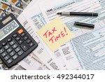 tax form with calculator  money ... | Shutterstock . vector #492344017