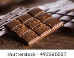 milk and dark chocolate on a... | Shutterstock . vector #492360037