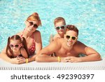 happy family in swimming pool... | Shutterstock . vector #492390397