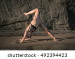 yoga poses on a sandy beach | Shutterstock . vector #492394423