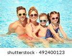 happy family in swimming pool... | Shutterstock . vector #492400123