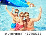 happy family in swimming pool... | Shutterstock . vector #492400183