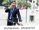 young businessmen with a bike | Shutterstock . vector #492425737