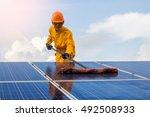 employee man cleaning of solar... | Shutterstock . vector #492508933