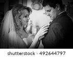 tender bride with curls put... | Shutterstock . vector #492644797