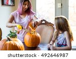 mother and daughter carving a... | Shutterstock . vector #492646987