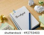 budget on notebook on desk | Shutterstock . vector #492753403