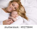 mother holding one month old... | Shutterstock . vector #49275844