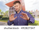 Small photo of Closeup portrait young funny looking man