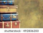 vintage pile ancient suitcases  | Shutterstock . vector #492836203