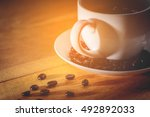coffee cup and saucer on a... | Shutterstock . vector #492892033