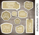 stickers on rustic wood... | Shutterstock . vector #492924793