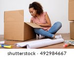 woman unpacking  her home... | Shutterstock . vector #492984667
